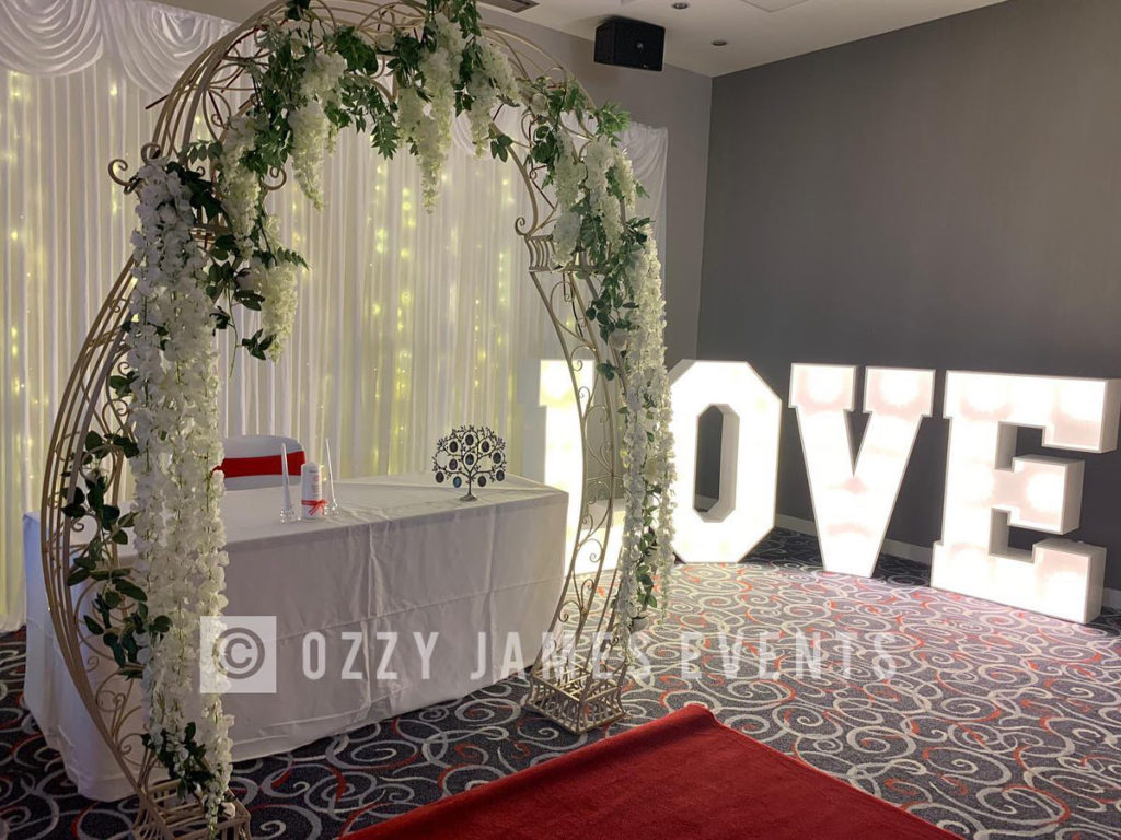 floral-wedding-arch-hire-ozzy-james-parties-events